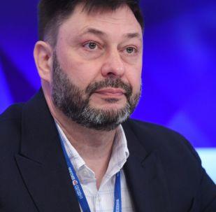 Šéfredaktor portálu RIA Novosti Ukrajina Kirill Vyšinský na tiskové konferenci v MIA Rossija Segodňa