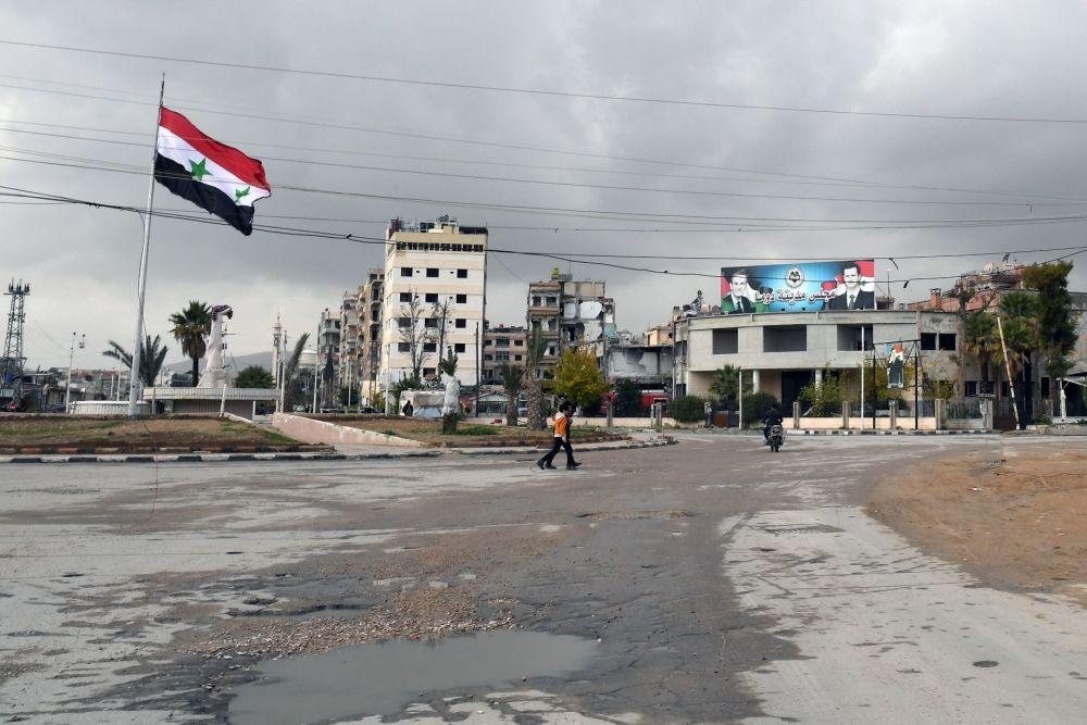 Jedna z ulic ve městě Dúmá, Sýrie