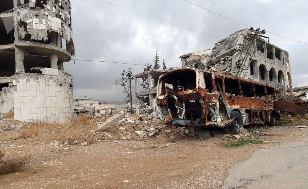Zničené domy ve městě Dúmá