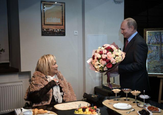 Ruský prezident Vladimir Putin a Galina Volček