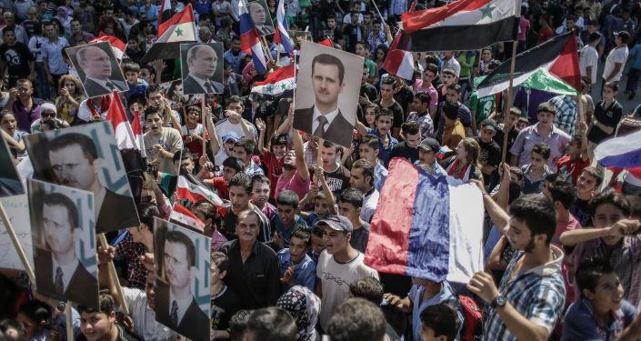 Mítink na podporu Bašára Asada a Vladimira Putina