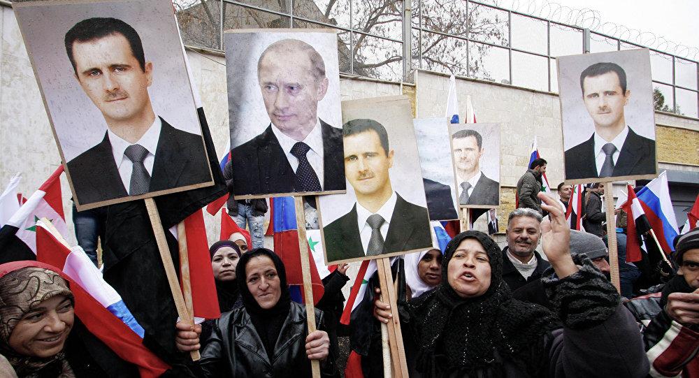 Fotografie Bašára Asada a Vladimira Putina