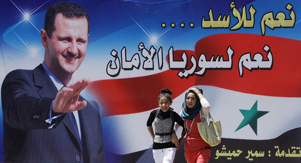 Billboard se zobrazením Bašára Asada