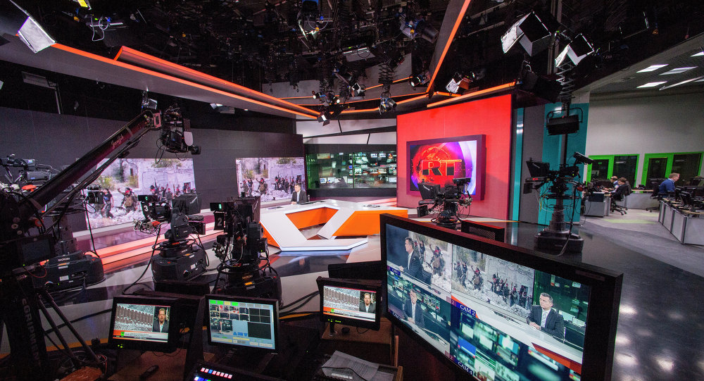 Russia Today newsroom during a live program in English.