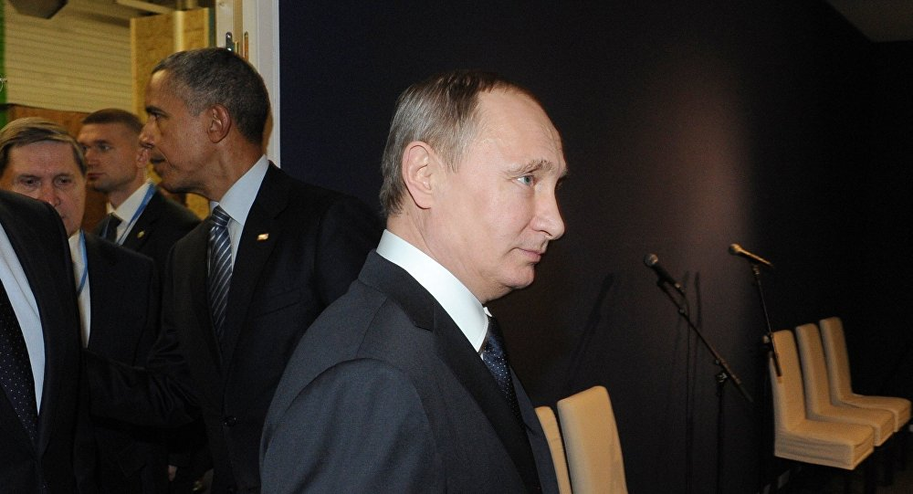 Ruský prezident Vladimir Putin a americký prezident Barack Obama ve Francii