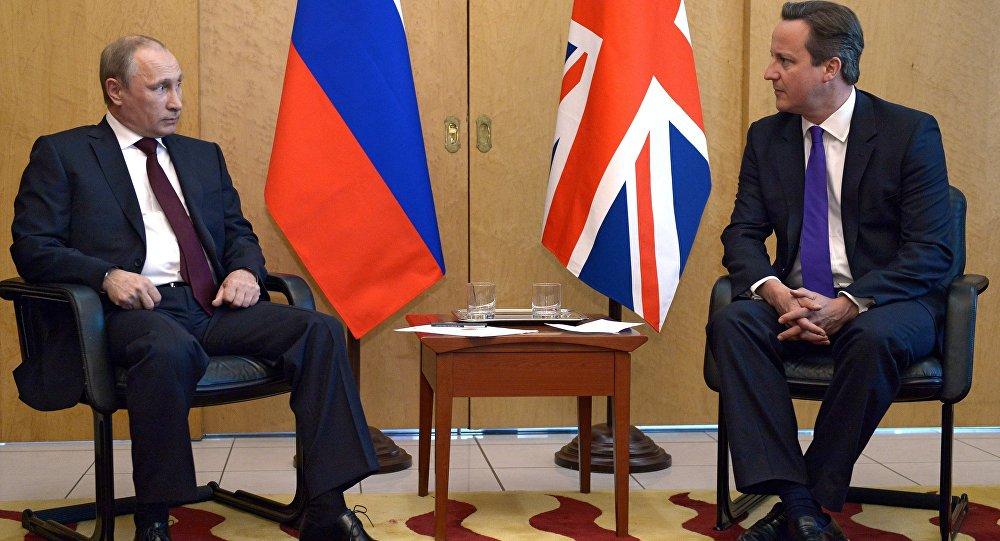 Vladimir Putin a David Cameron