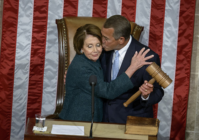 House Minority Leader Nancy Pelosi, D-CA, is kissed as she hands over the gavel to Speaker of the House John Boehner, R-OH, during a swearing-in ceremony in the House of Representatives as the 114th Congress convenes on Capitol Hill January 6, 2015 in Washington, DC