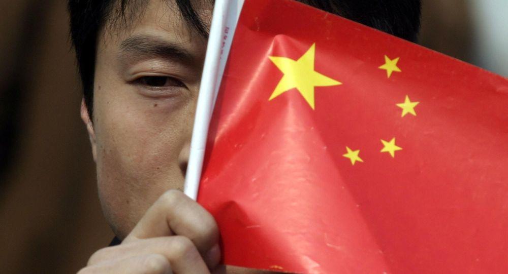 Číňan drží japonskou vlkajku