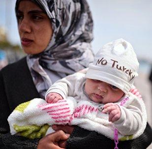 Syrští migranti, kteří uprchli z Turecka