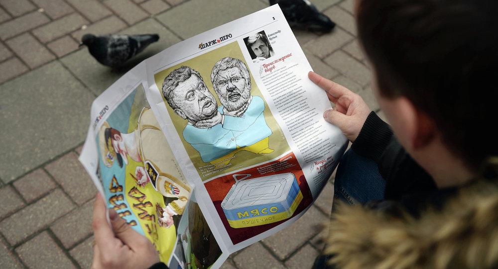 Сhlap čte karikaturní časopis