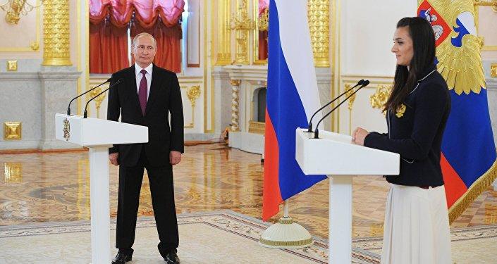 Ruský prezident Vladimir Putin během setkání s ruskou reprezentací