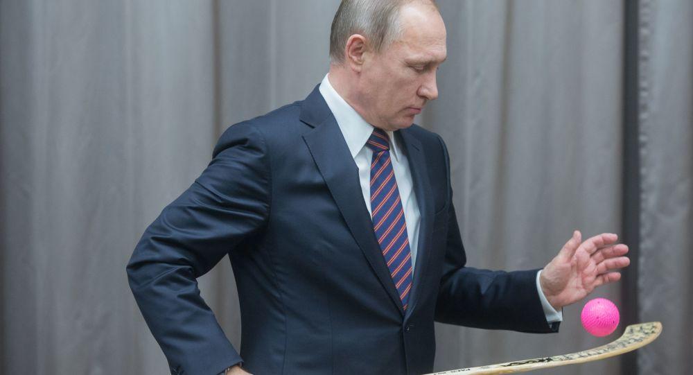 Vladimir Putin během setkání s ruskou reprezentací