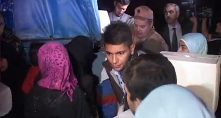 Syřané písněmi vítali autobusy s osvobozenými obyvateli východního Aleppa
