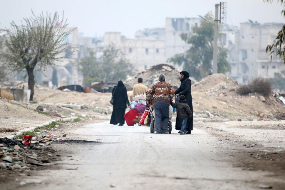 Běženci v okolí Aleppa