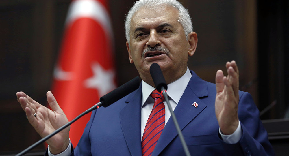 Turkey's Prime Minister Binali Yildirim addresses lawmakers at the parliament a day after he announced the details of an agreement reached with Israel.