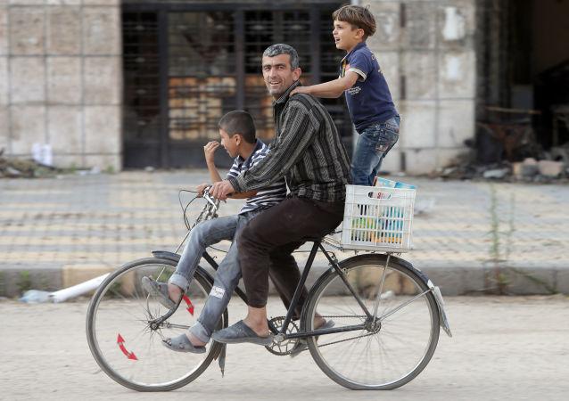 Syřané v ulicích Homsu