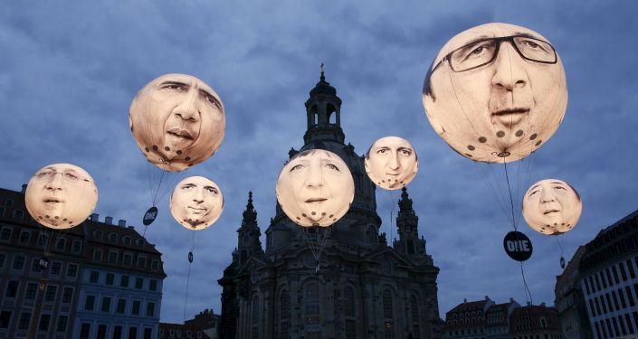 Summit ministrů financí zemí G7 v Drážďanech. Portréty lídrů G7 na balónech