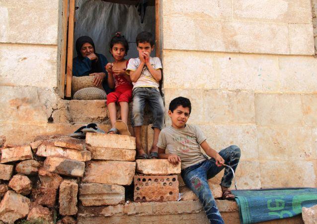 Děti z rodiny uprchlíků v Aleppu