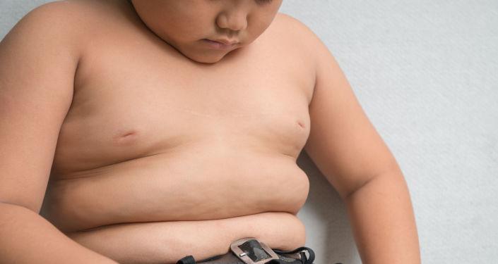 Tlustý chlapec. Ilustrační foto