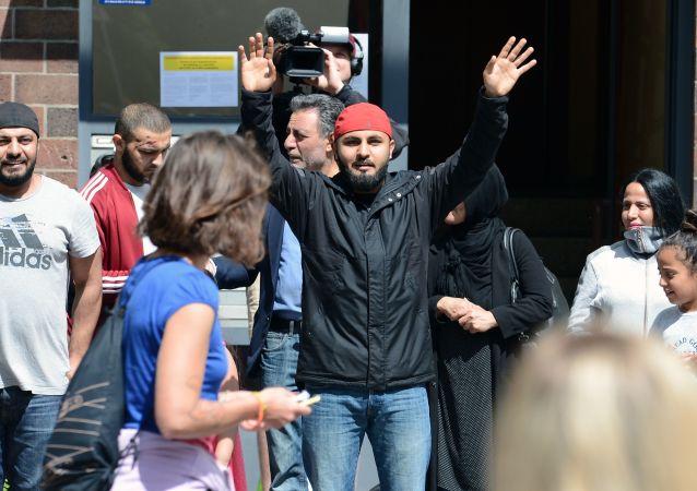 Migranti v Berlíně