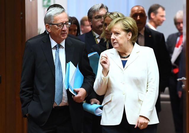 Jean-Claude Juncker a Angela Merkelová