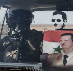 Syrský letec s portrétem Asada
