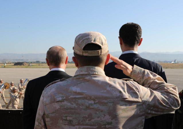 Ruský prezident Vladimir Putin a syrský prezident Bašár Asad