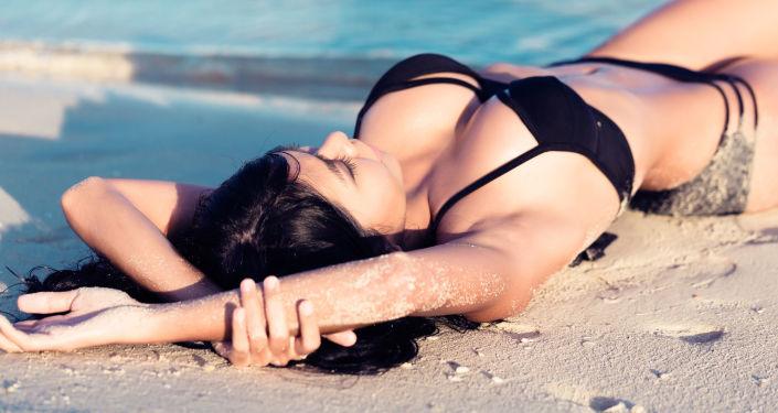 Dívka na pláži