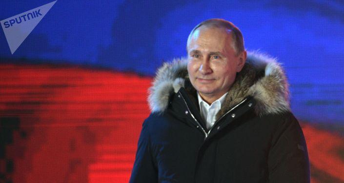 Ruský prezident Vladimir Putin na koncertě věnovaném sjednocení Krymu s Ruskem