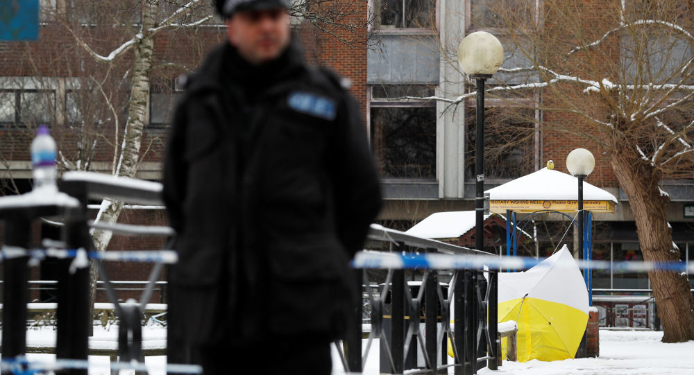 A police officer stands at the cordon near the tent covering the park bench where former Russian intelligence officer Sergei Skripal and his daughter Yulia were found poisoned in Salisbury