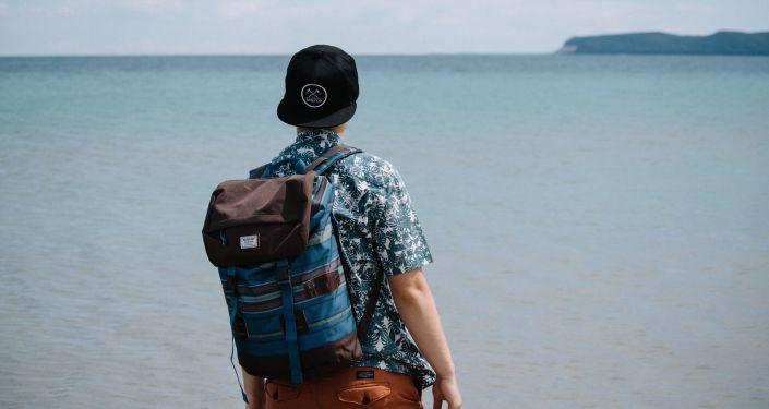 Člověk u moře. Ilustrační foto