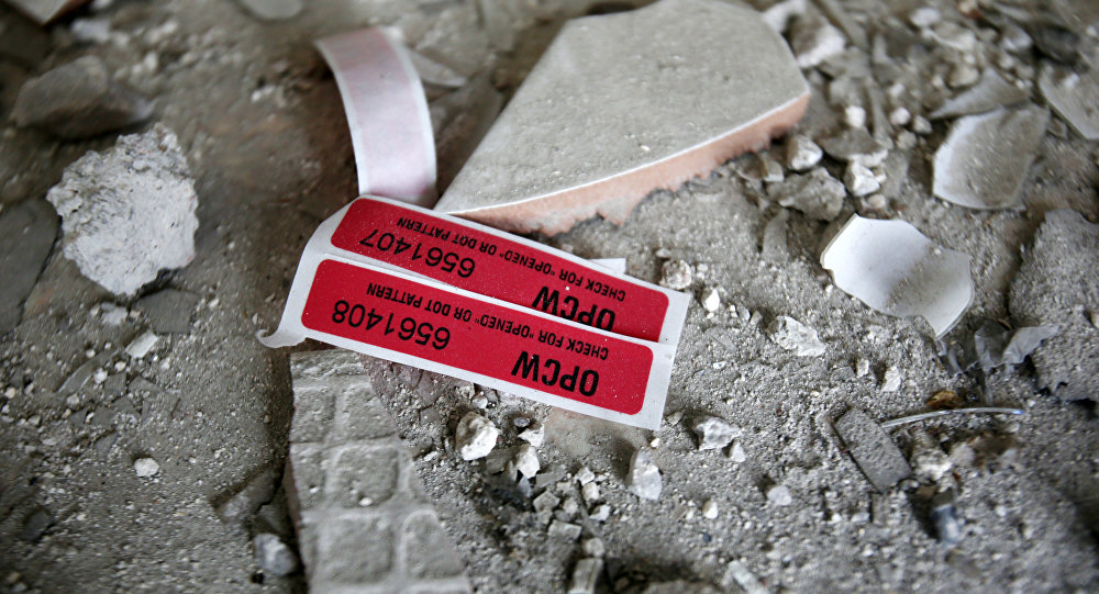 Labels of the Organisation for the Prohibition of Chemical Weapons (OPCW) are seen iside a damaged house in Douma in Damascus, Syria April 23, 2018