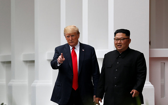 U.S. President Donald Trump and North Korean leader Kim Jong Un walk after lunch at the Capella Hotel on Sentosa island in Singapore June 12, 2018.