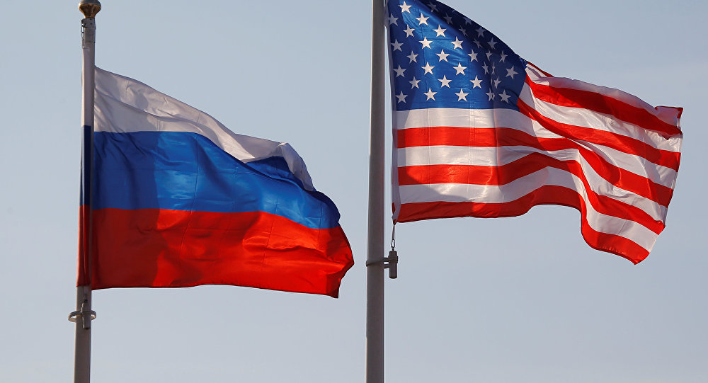 National flags of Russia and the US fly at Vnukovo International Airport in Moscow, Russia April 11, 2017