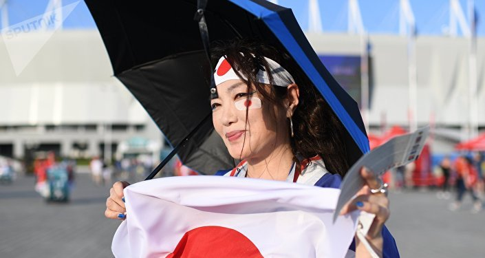 Japane's fan before the match of the 1/8 finals of the World Cup between the national teams of Belgium and Japan
