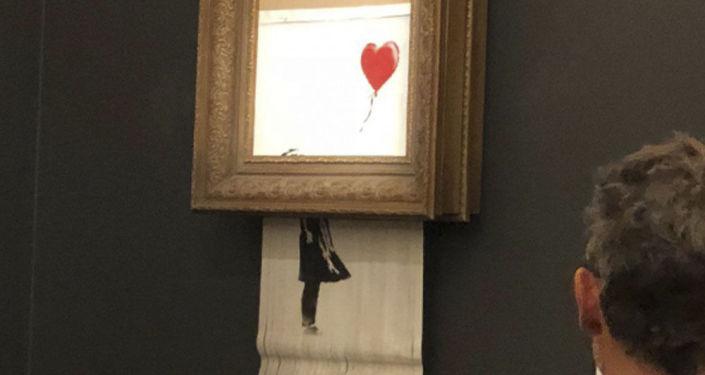 Jedno z nejznámějších děl malíře Banksyho Dívka s balonkem
