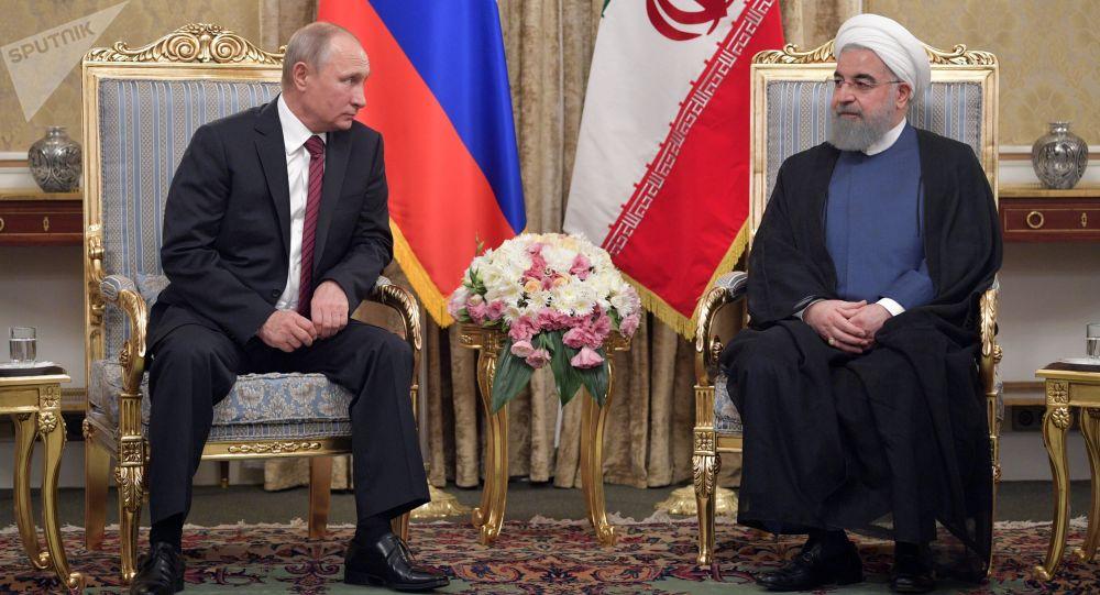 Vladimir Putin a Hasan Rúhání