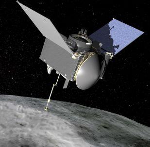 Sonda OSIRIS-REx nad asteroidem Bennu (grafická ilustrace)