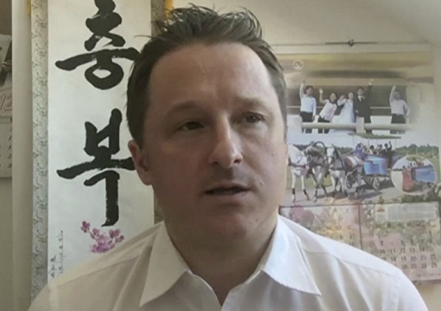 In this image made from video taken on March 2, 2017, Michael Spavor, director of Paektu Cultural Exchange, talks during a Skype interview in Yangi, China