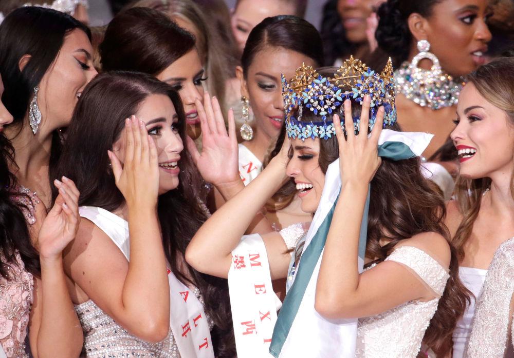 Tento týden v obrázcích: Miss World 2018, plameny i chlad