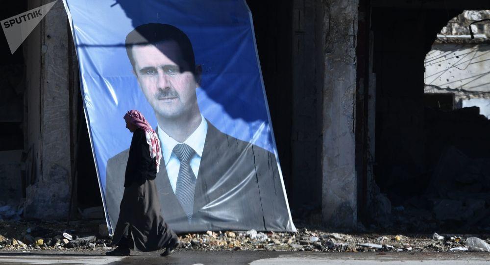 Portrét syrského prezidenta Bašára Asada v Aleppu