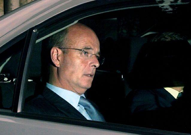 Bývalý ředitel MI6 John Scarlett
