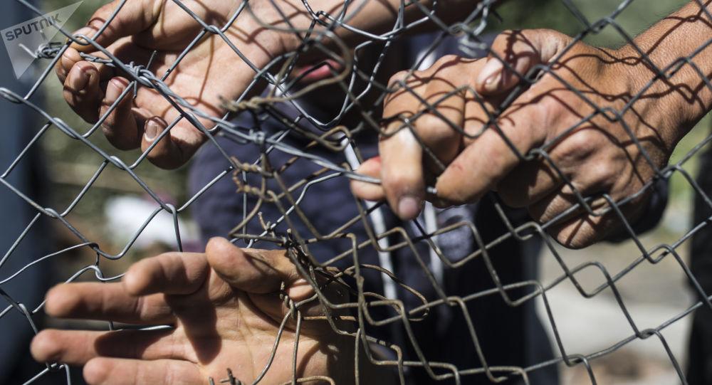 Migranti v uprchlickém táboru Moria v Řecku