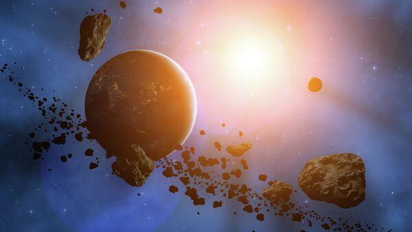 Planeta v obklopení asteroidů. Ilustrační foto - Sputnik Česká republika