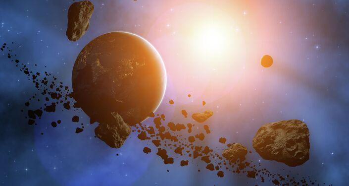 Planeta v obklopení asteroidů. Ilustrační foto