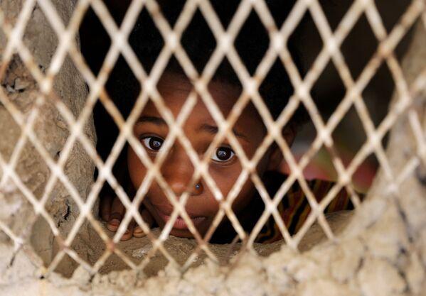 Dítě ve slumu v hlavním městě San'á. - Sputnik Česká republika