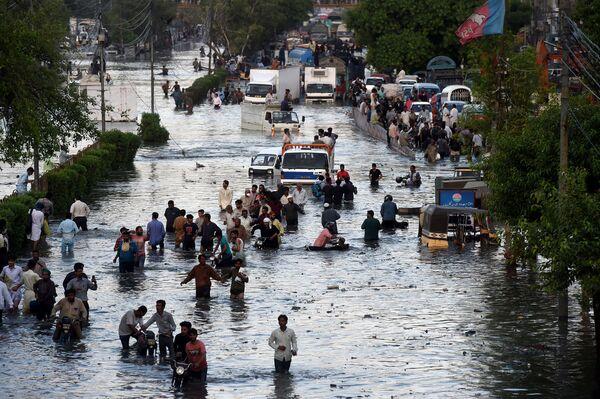 Povodně v pákistánském městě Karáčí. - Sputnik Česká republika