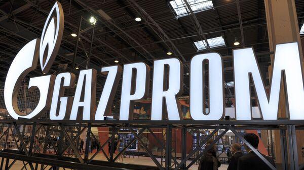 Logo společností Gazprom - Sputnik Česká republika