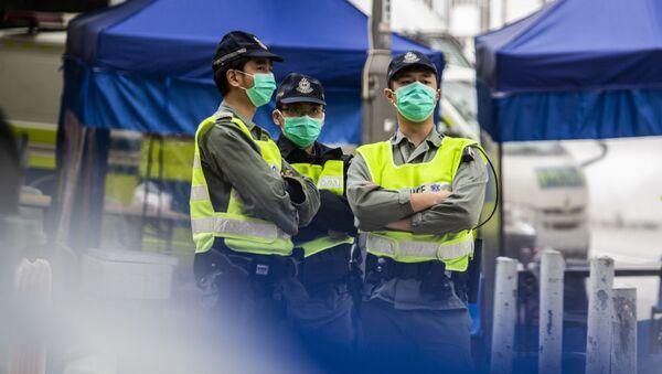 Policisté v Hongkongu - Sputnik Česká republika