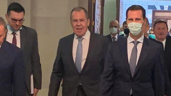 Ruský ministr zahraničí Sergej Lavrov a syrský prezident Bašár Asad - Sputnik Česká republika